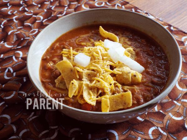 bowl of chili on football tablecloth