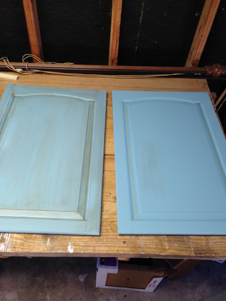 The door on the right has two coats of paint. The door on the left has been glazed.