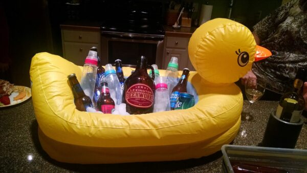 inflatable duck cooler filled with beer and baby bottles