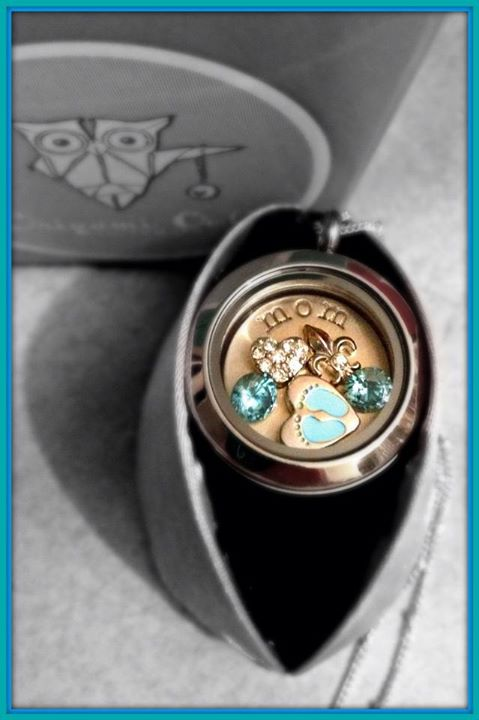 origami owl locket filled with blue crystals