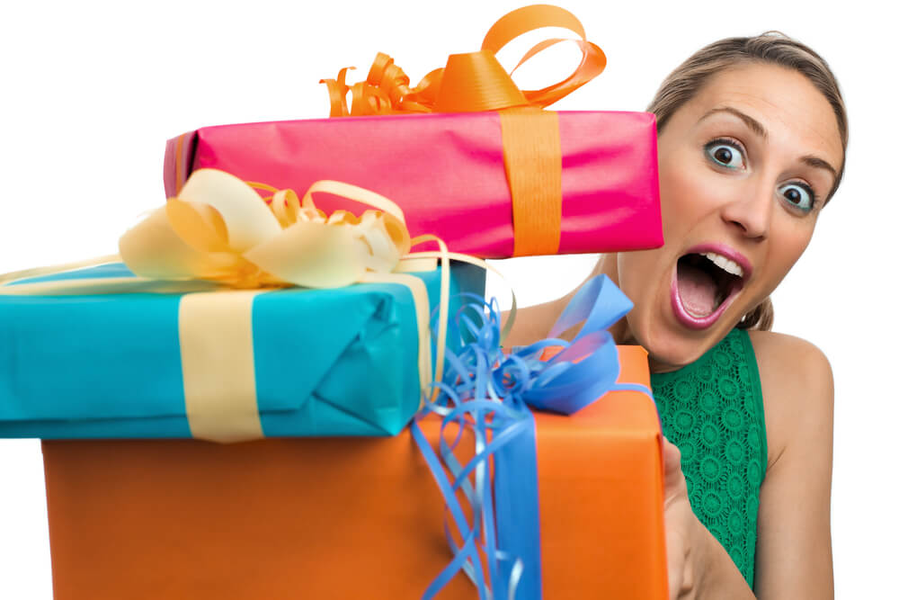 woman holding a large pile of presents